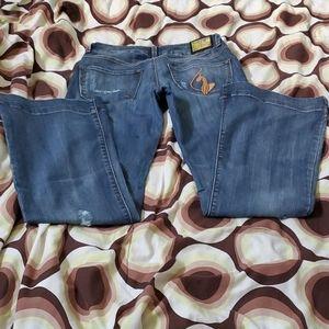 Women Baby Phat Blue wide bottom Jeans in a Size 5
